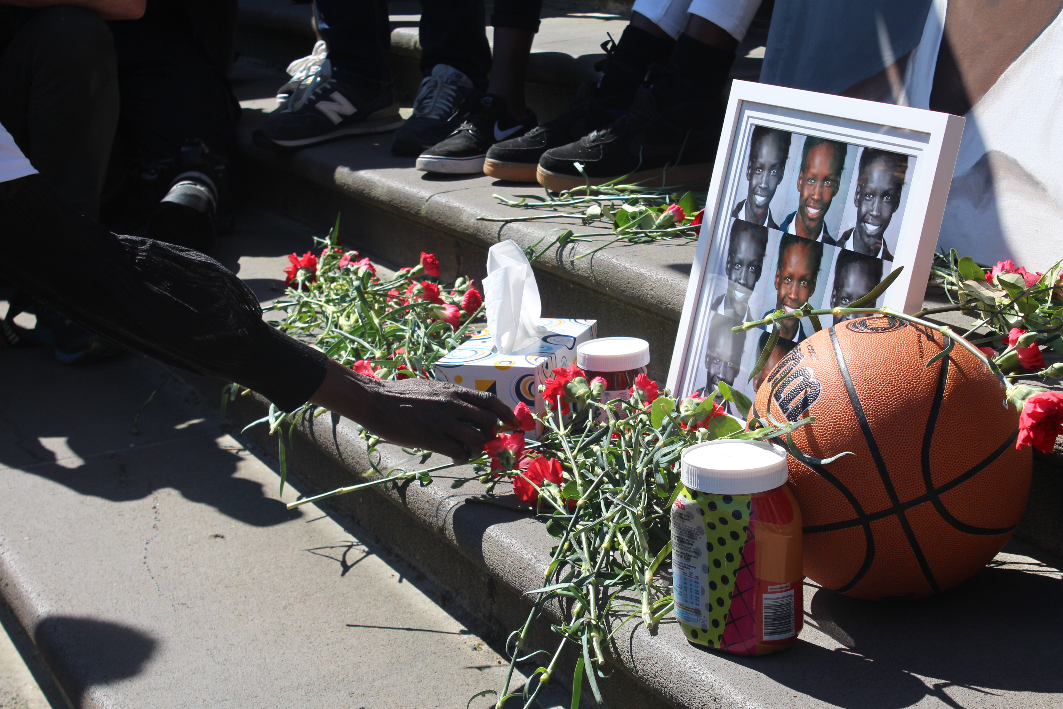Flowered were laid to remember Liep Gony and call for solidarity with Melbourne's South Sudanese community.