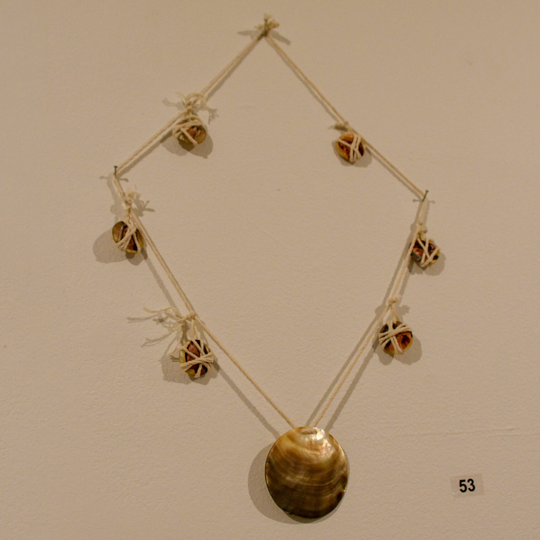 Edwina Green's piece,<em>Not A Maireener Shell Necklace,</em> on the wall at the Koorie Art Show