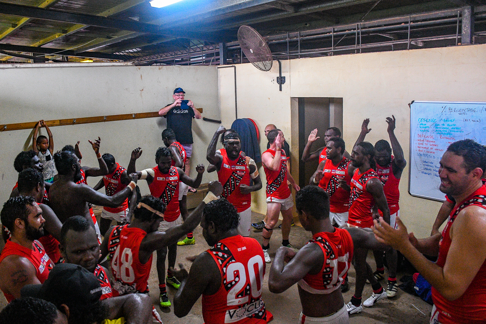 The Bombers celebrate after beating the Crocs in round 14.