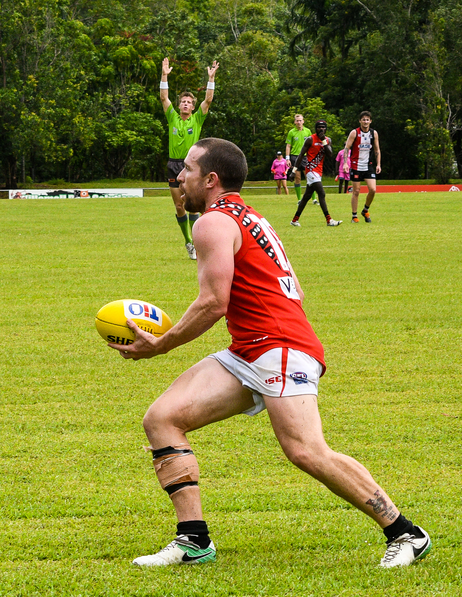 Ashton Ham, with his calf heavily taped, fires off a handball against the Crocs in round 14