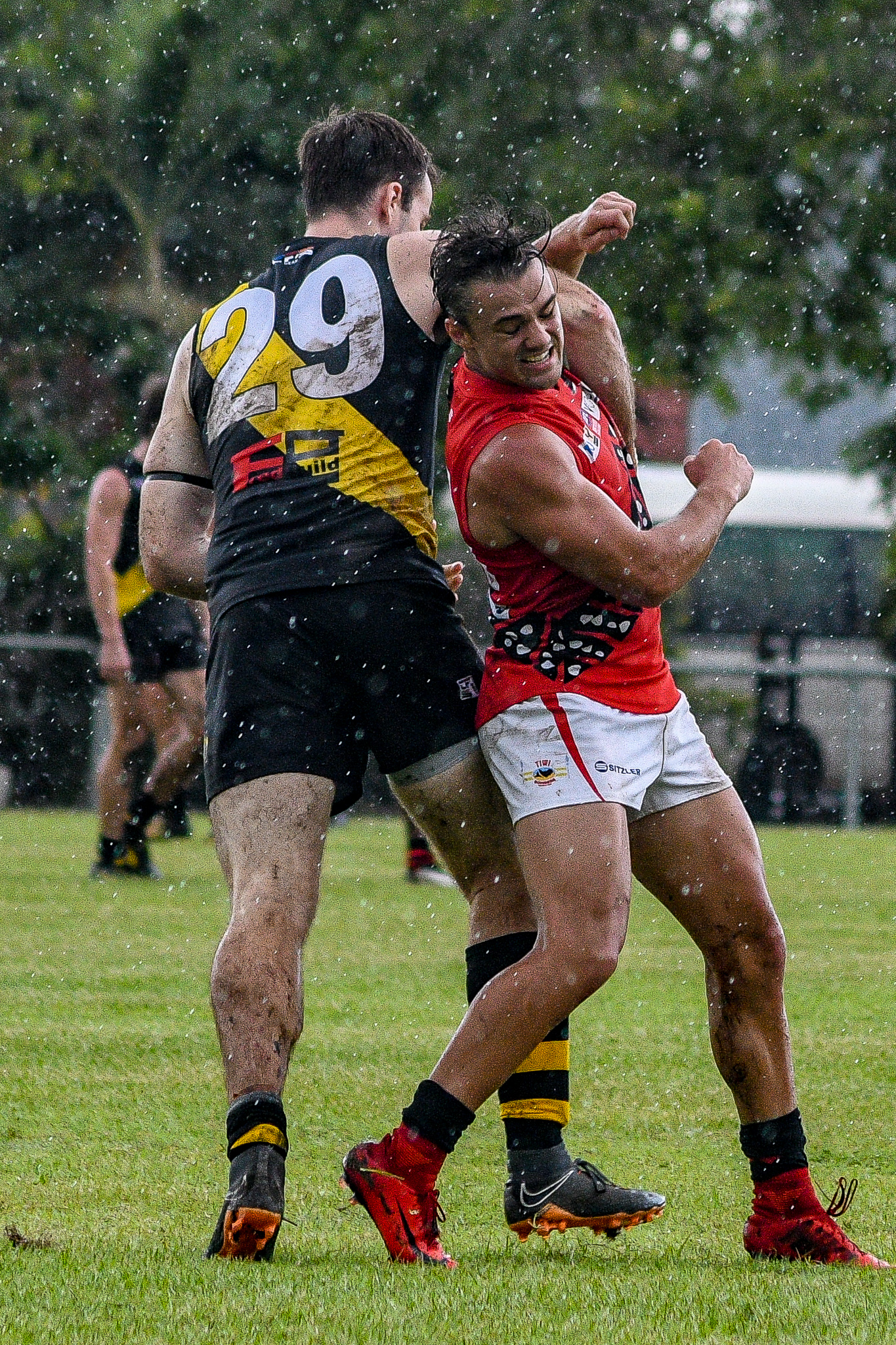 Christian Burgess cops an elbow from Nightcliff's Shaun Wilson during the round 15 clash between the two sides