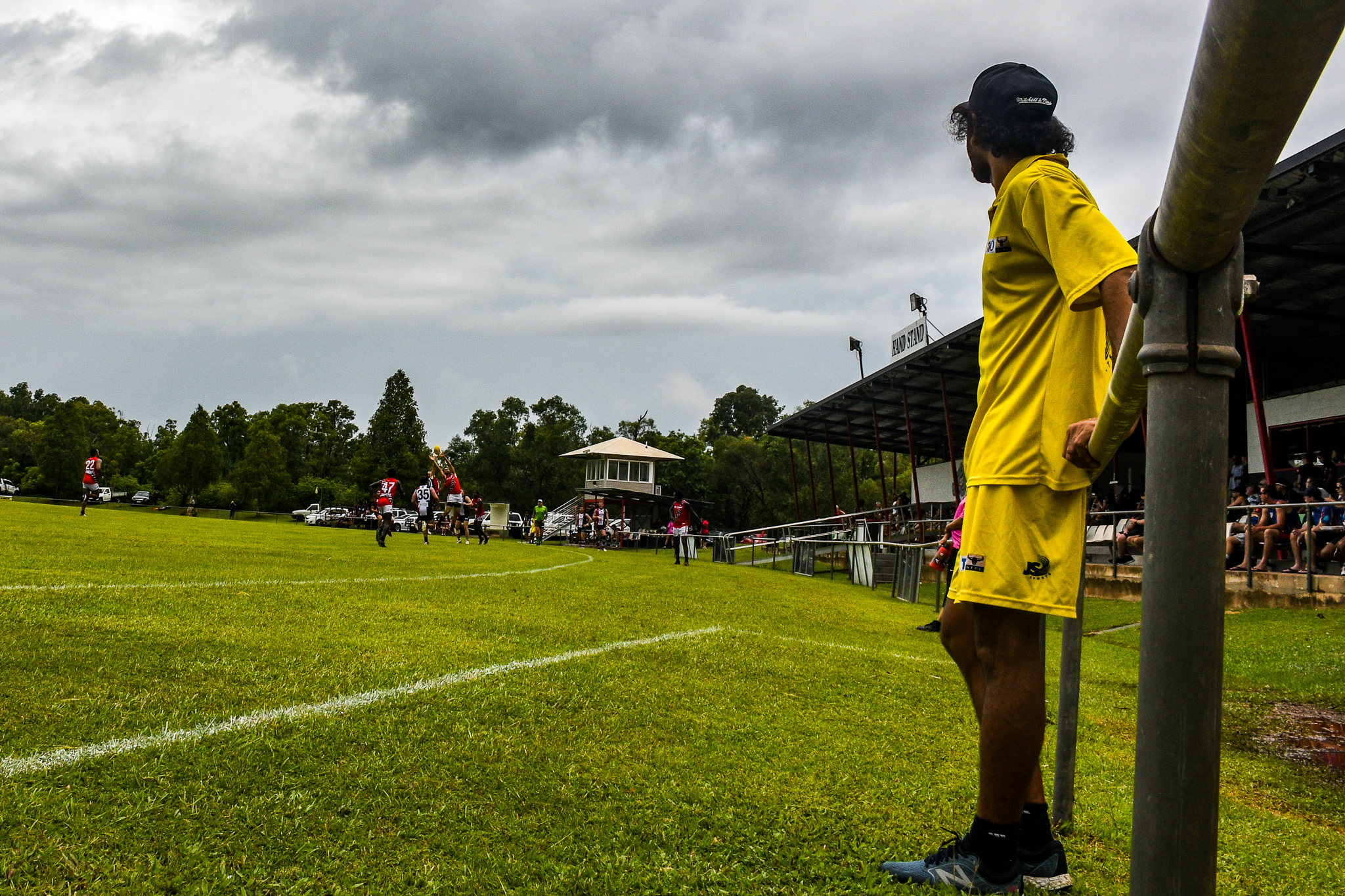 Cyril Rioli Jnr – a four-time AFL premiership player with Hawthorn – watches on from the sidelines. Rioli started running for the Tiwi team in round 13. He retired from the AFL in July 2018 so he could return to the Top End and be closer to his family. Tiwi Bombers v Southern Crocs, NTFL round 14, January 19, 2019