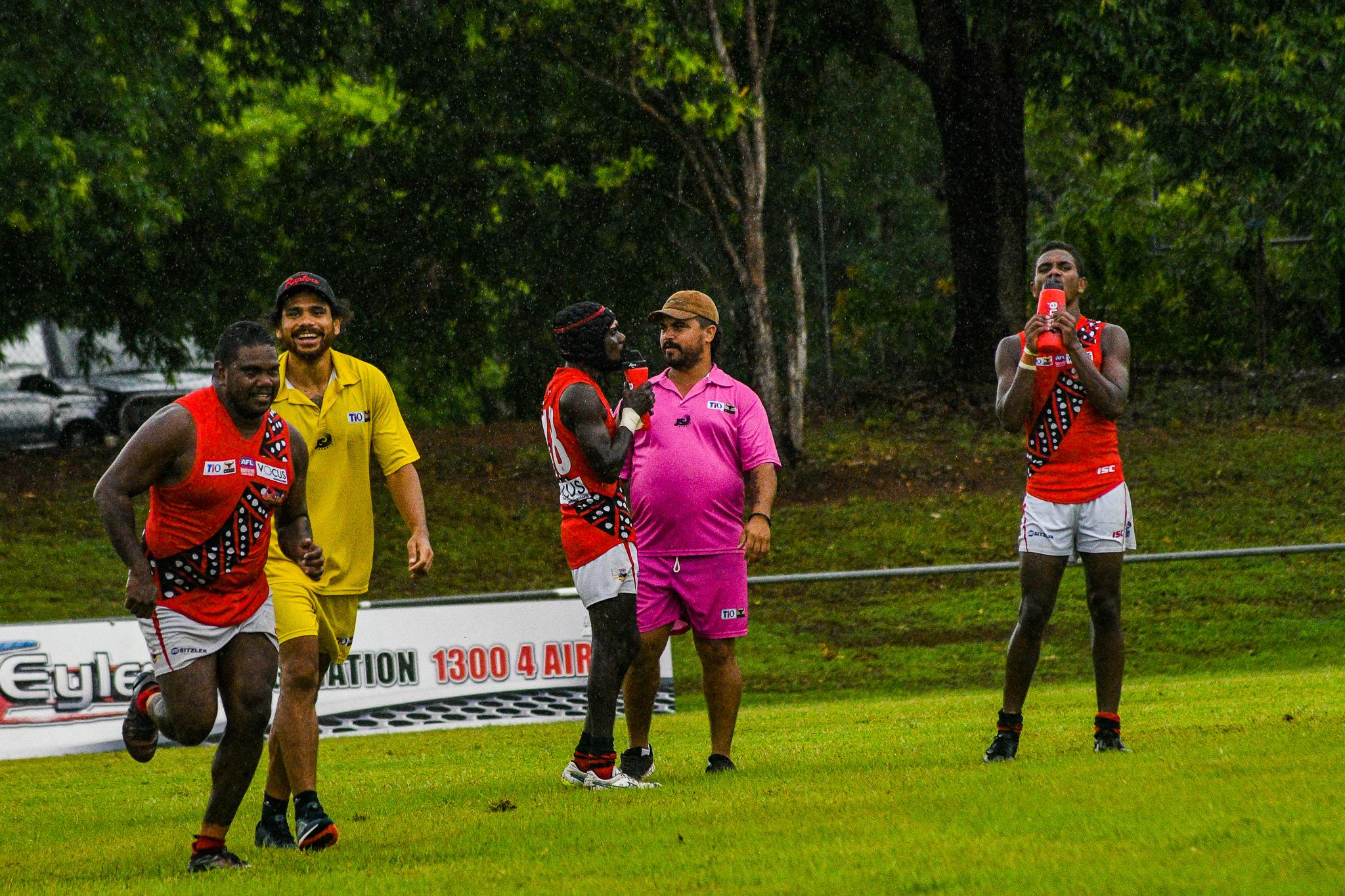 "Cyril Rioli Jnr sends Austin ""Ossie"" Wonaeamirri to the bench after a last quarter goal.Tiwi Bombers v Southern Crocs, NTFL round 14, January 19, 2019."