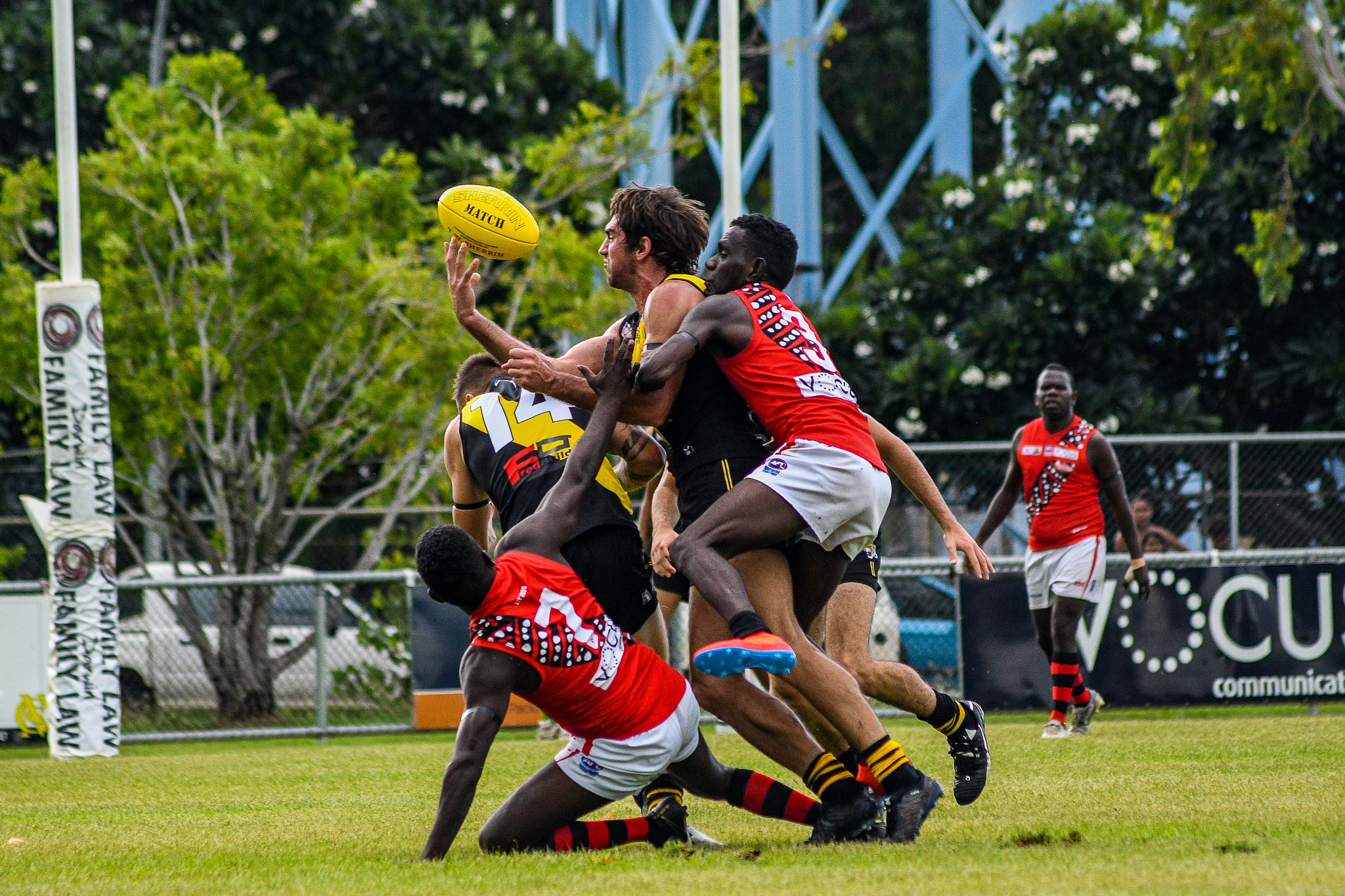 It's hard to shake Dion Munkara off. Here, he leaves the ground to lay a tackle against Nightcliff. Tiwi Bombers v Nightcliff Tigers, NTFL round 15, January 27, 2019.