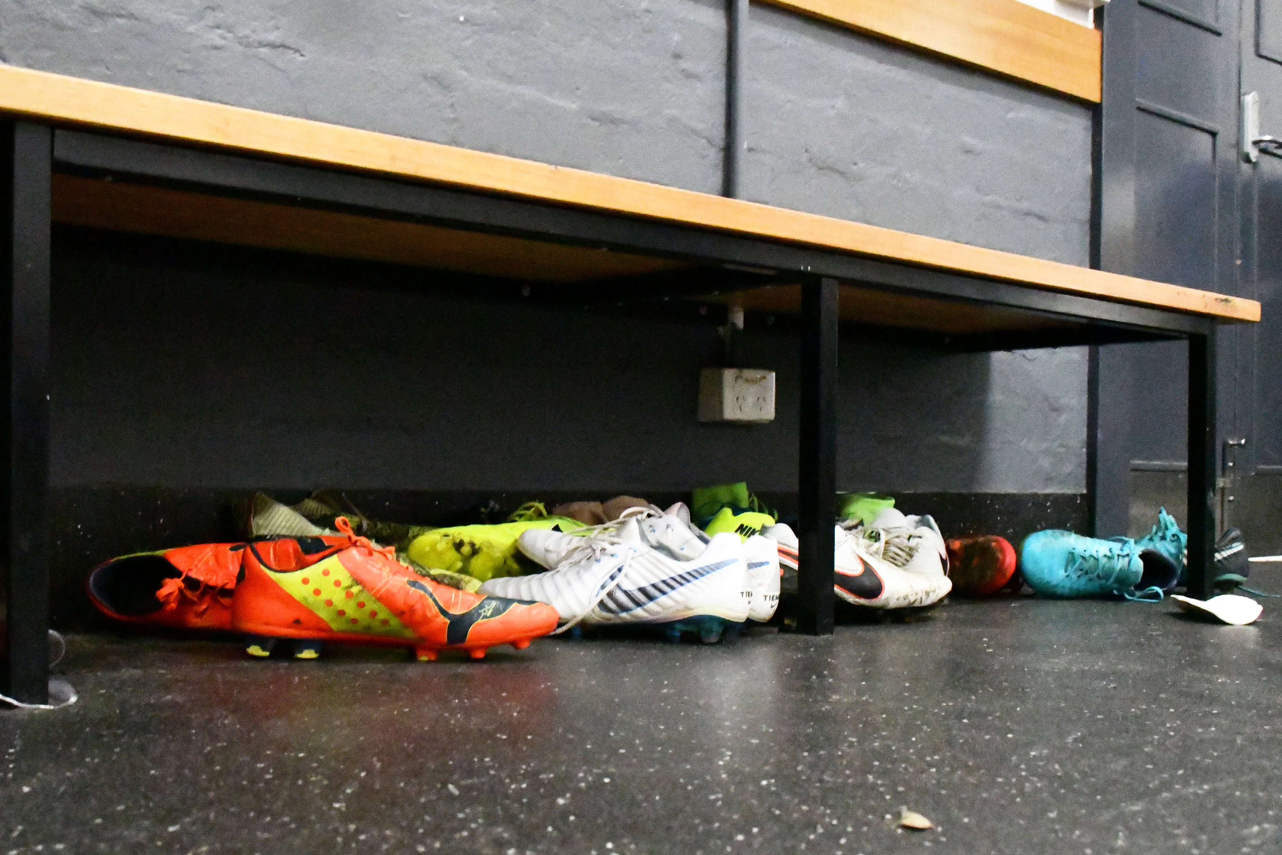 Port Melbourne players leave their boots under a bench in the change rooms after a Thursday night training session at North Port Oval.