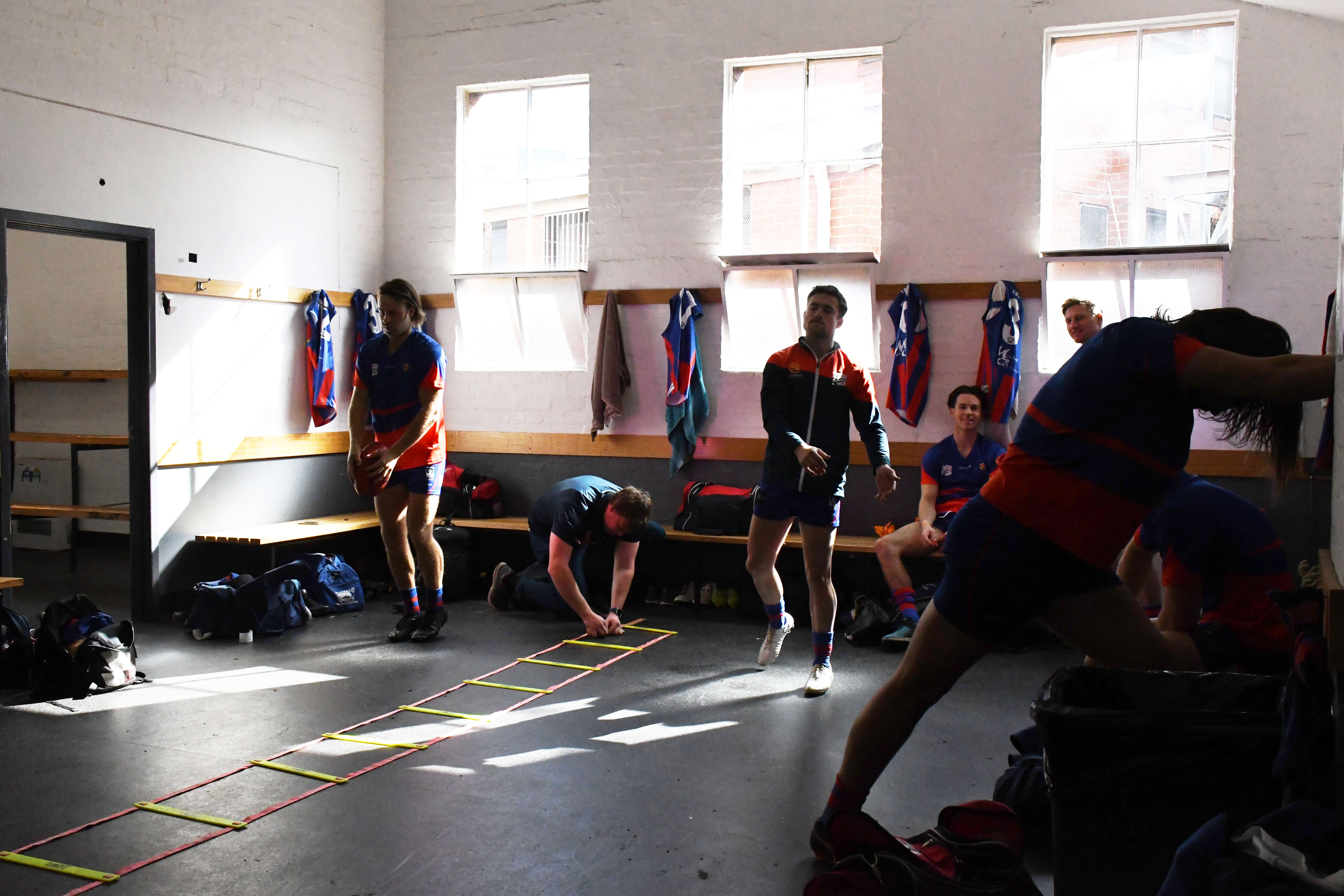 Players Mackenzie 'Mac' Rivett and Tom O'Sullivan (Snr) prepare for the clash against Collingwood on 11th August 2018 with short kicks and handballs in the change rooms. With just two rounds left of the season, Port Melbourne needs to hold their position in the top eight to be eligible for finals.
