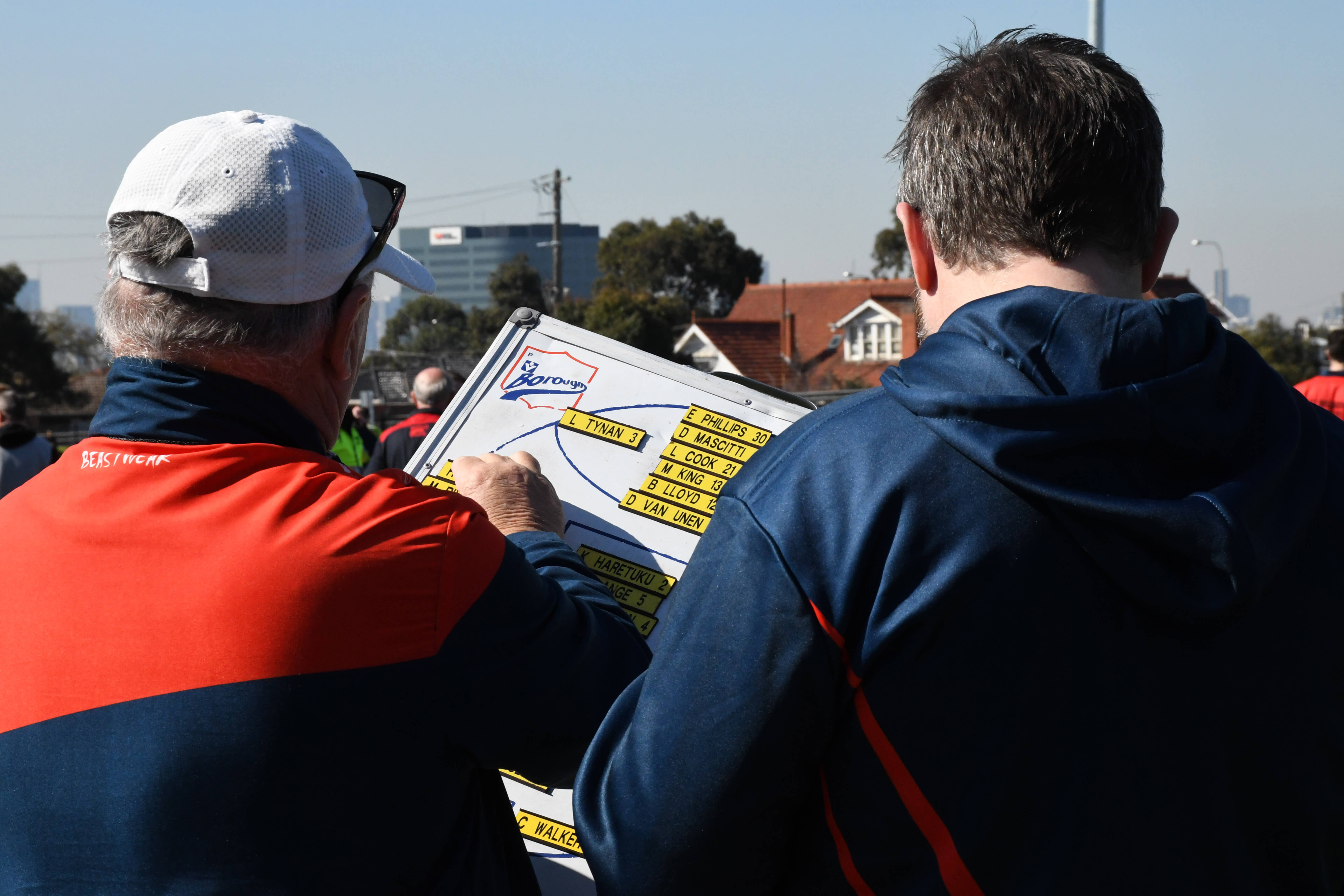 Senior boardman Les Quarrell and coaching assistant Trevor Hurley plan the player interchange board in the quarter time break during the Round 21 clash on 25th August 2018 against Footscray at VU Whitten Oval.