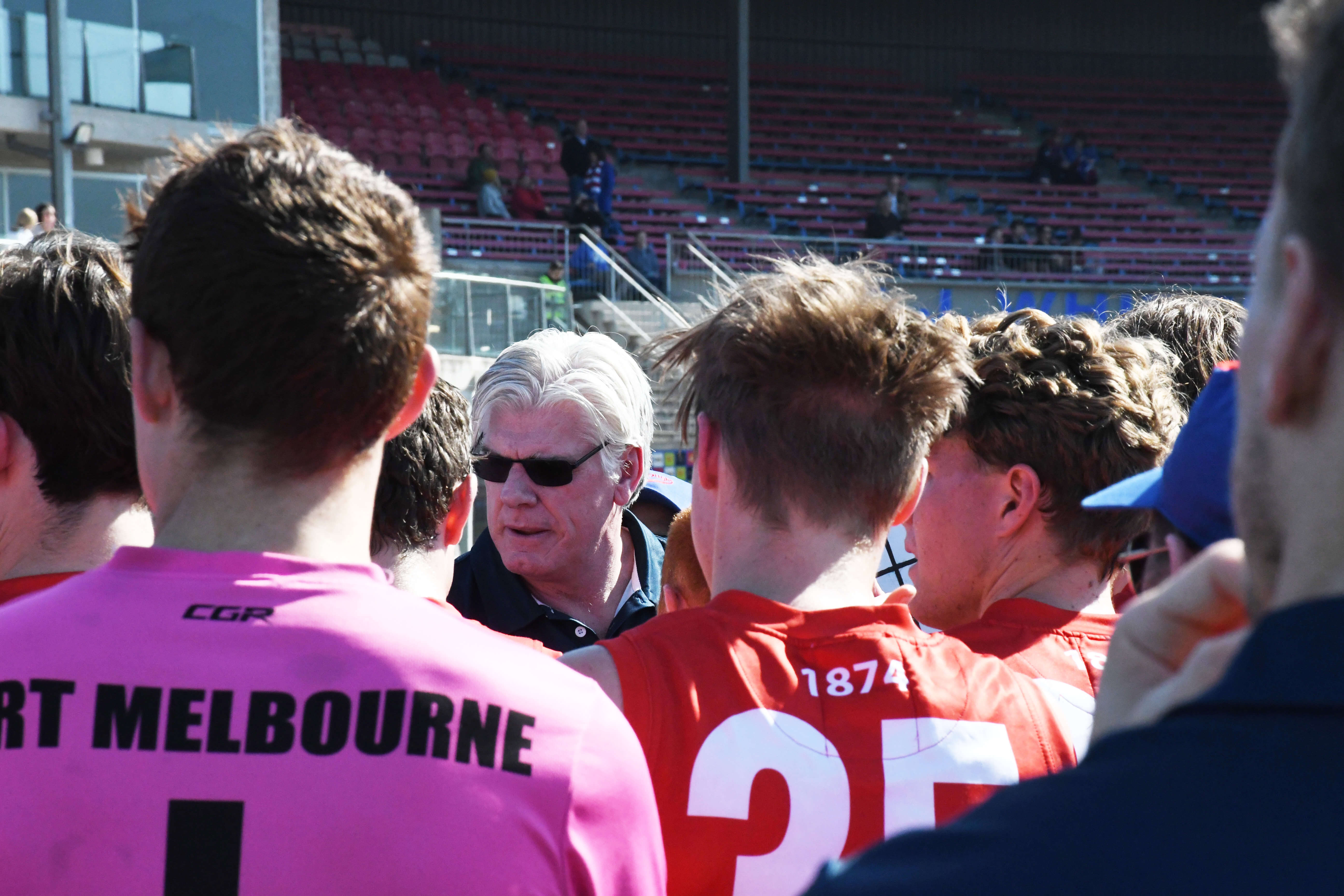 Coach Gary Ayres speaks to players during the quarter-time huddle. Port Melbourne leads 5.5-35 to Footscray's 2.2-14 at quarter time in the last round of the regular season.