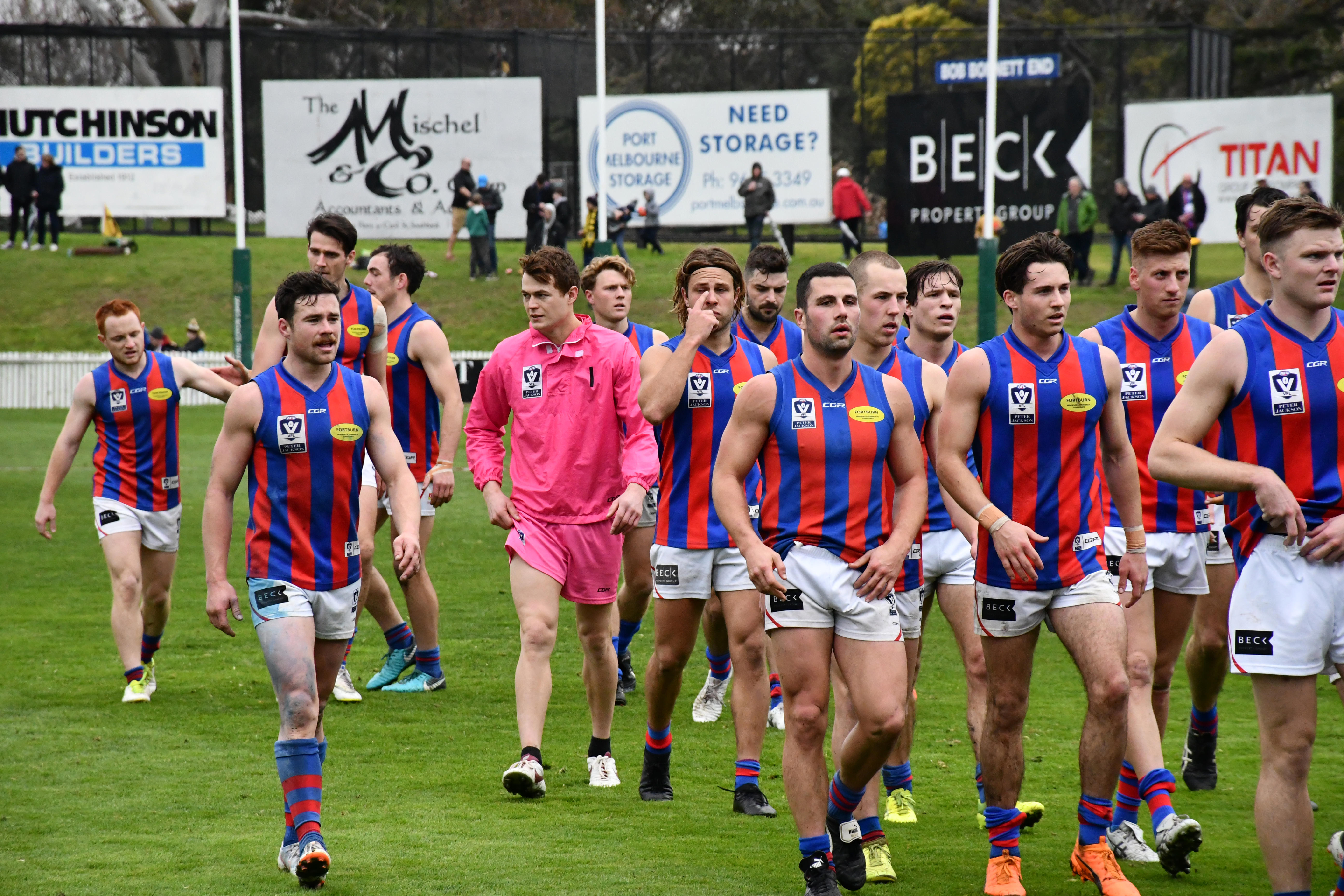 After an 83-point full-time draw, Port Melbourne and Box Hill play in extra time for a position in the finals on 1st September. Port Melbourne were defeated by 13 points and their 2018 season came to an end. Ex-Port player now team runner Josh Tynan consoles players as they walk off the field. (By Sophie Simpson).