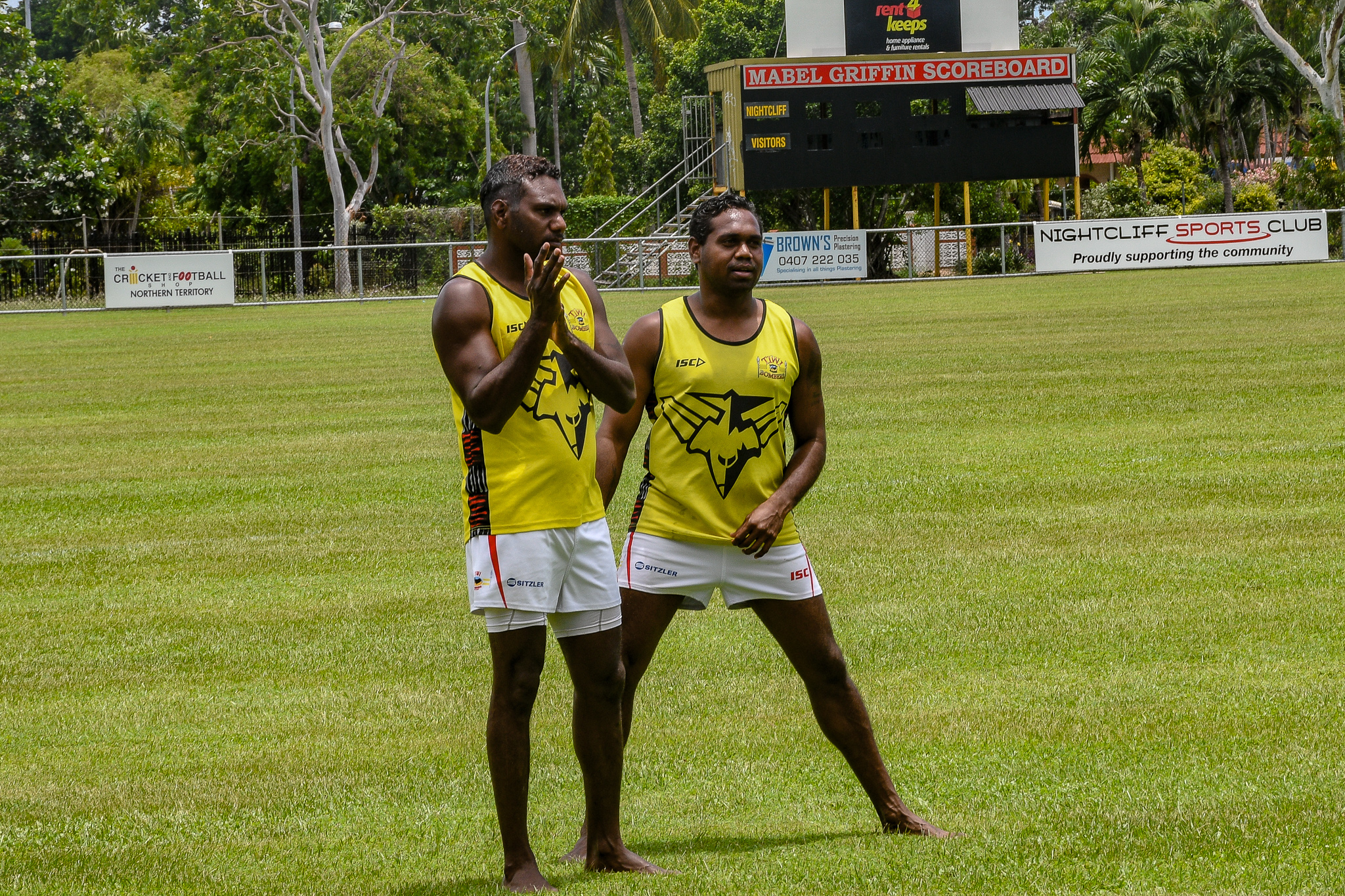 Patrick Heenan Jnr (right) stretches during a bit of pre-game kick to kick ahead of the Bombers' round 15 game against Nightcliff