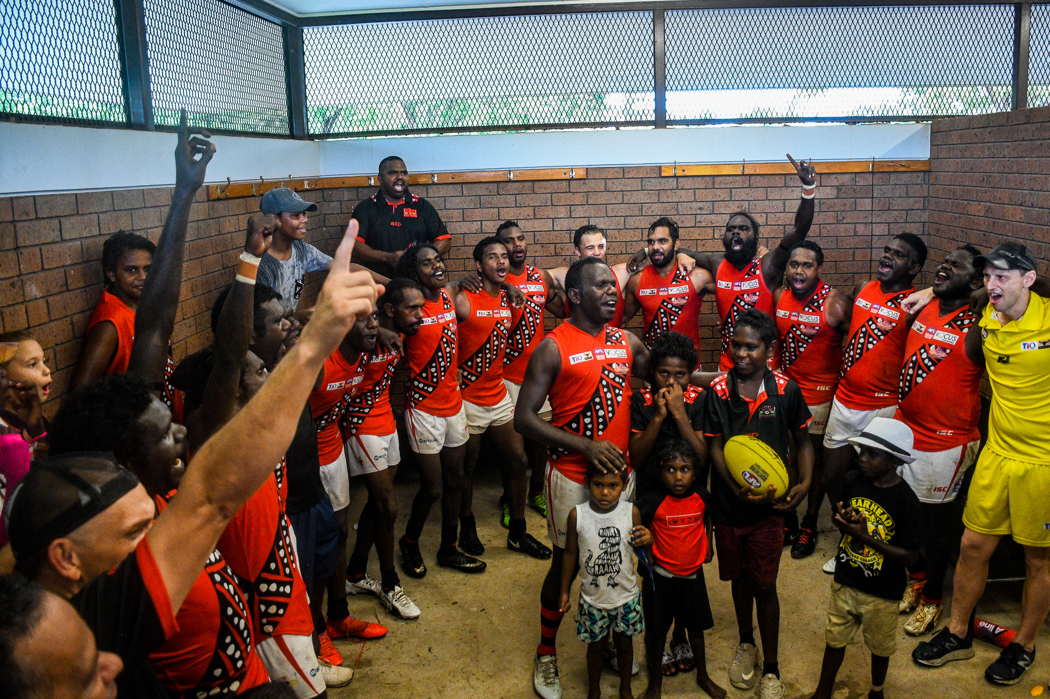 The Tiwi Bombers sing their song after beating Nightcliff during round 15 of the NTFL season