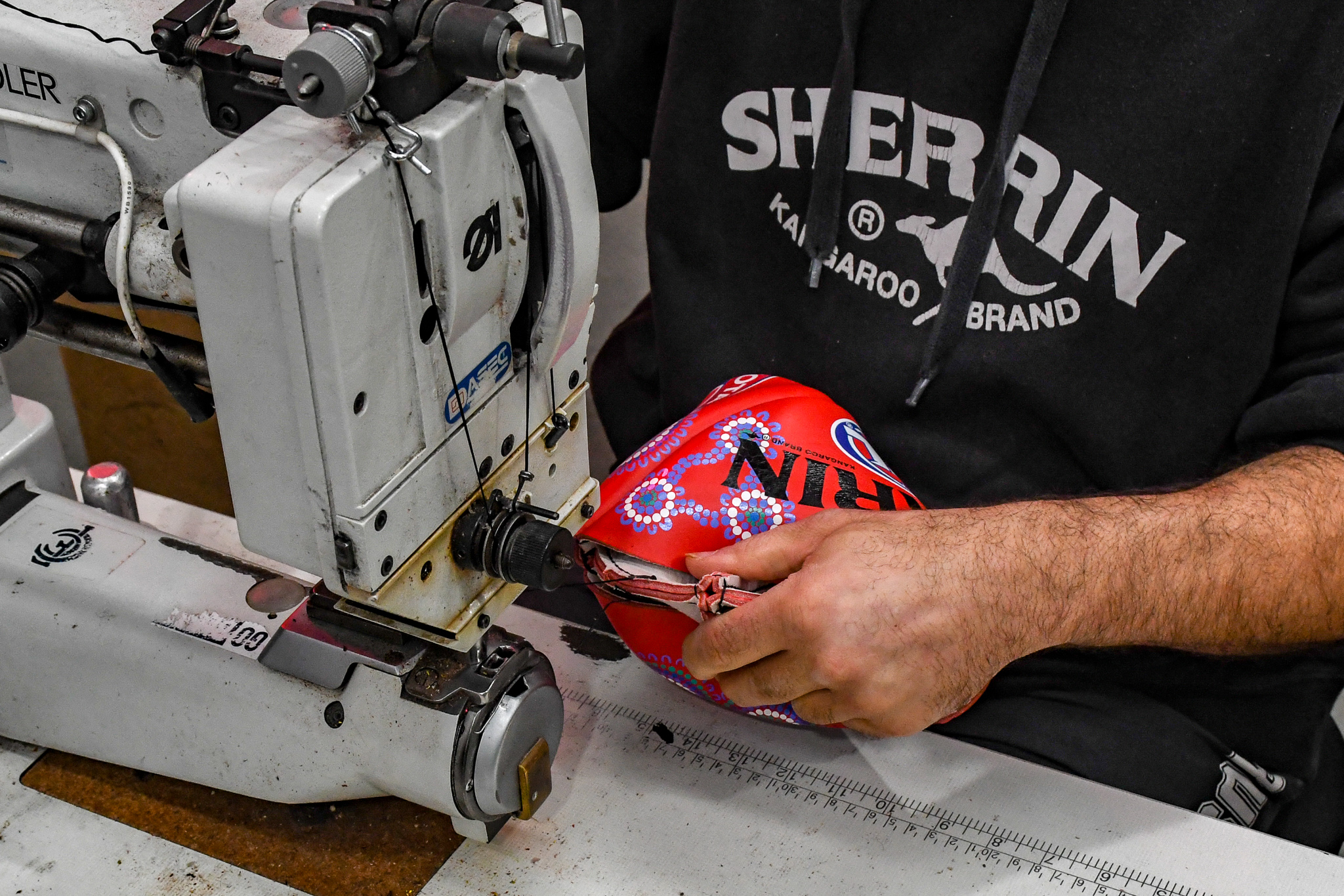 The 2019 Sir Doug Nicholls Round match balls were handmade at the Sherrin factory in Scoresby