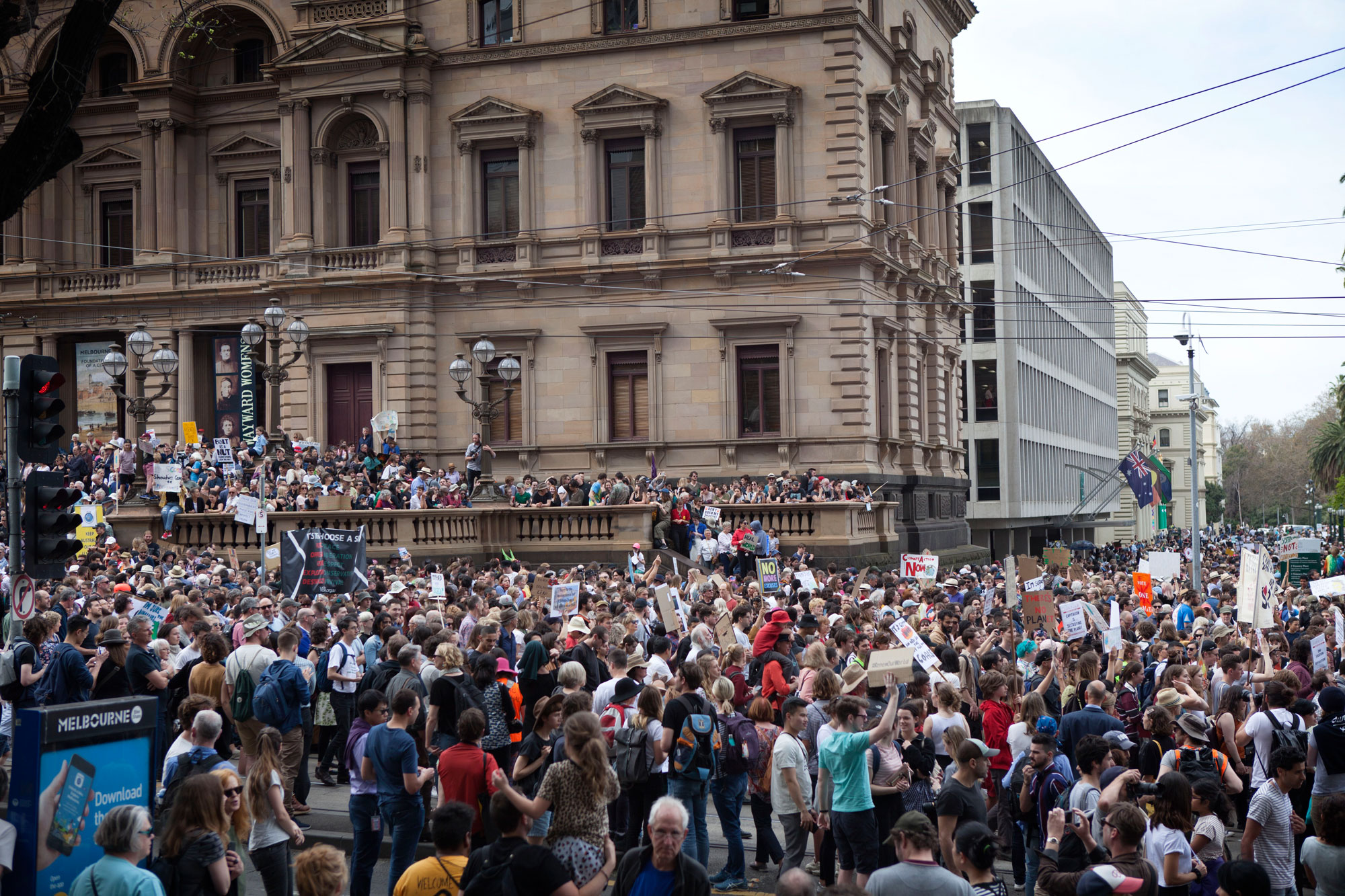An estimated 100,000 spill around the front of the Old Treasury Building in Melbourne for the Global Climate Strike Rally. Photo: Fangying Zhou