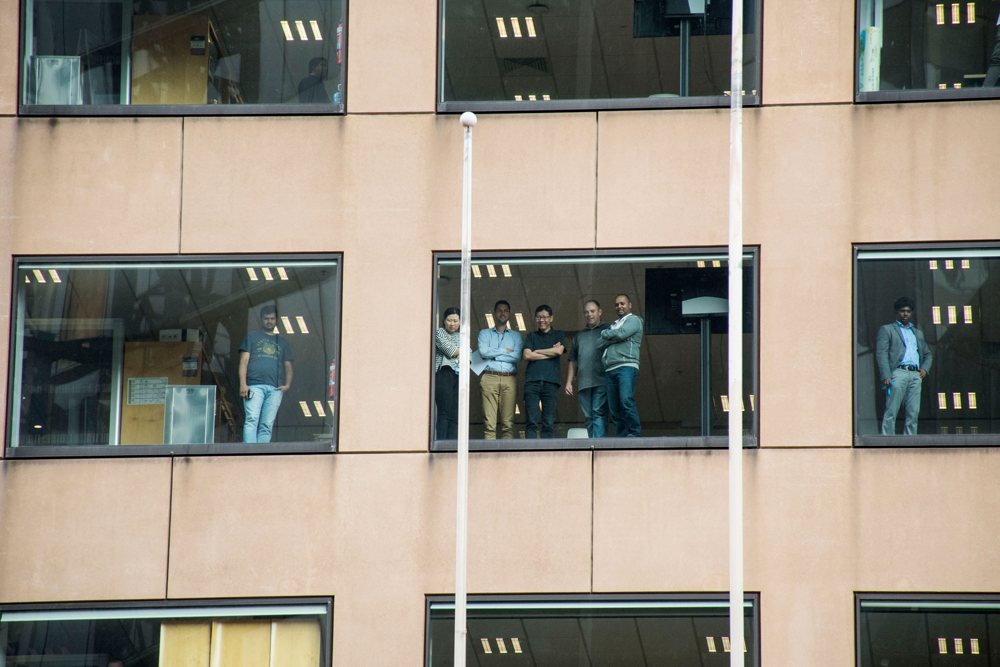 Office workers above 55 Collins Street look down on Melbourne's Global Climate Strike. Photo: Liam Petterson