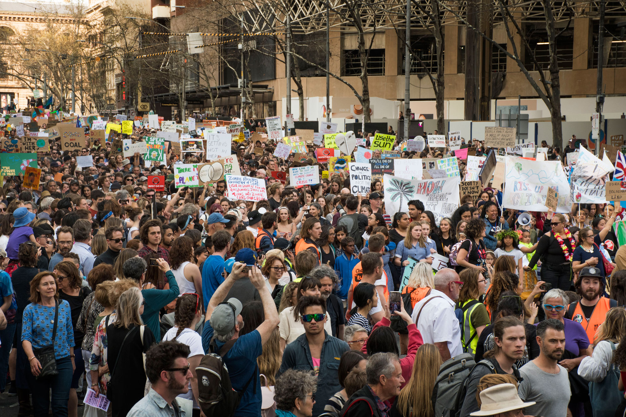 Crowds congregate on the corner of Collins and Exhibition street.  Photo: Liam Petterson