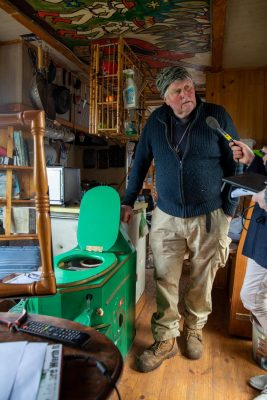 Farmer Ken Rowley and his musical toilet, on which he performs his songs on issues including the plight of the planet and climate change.