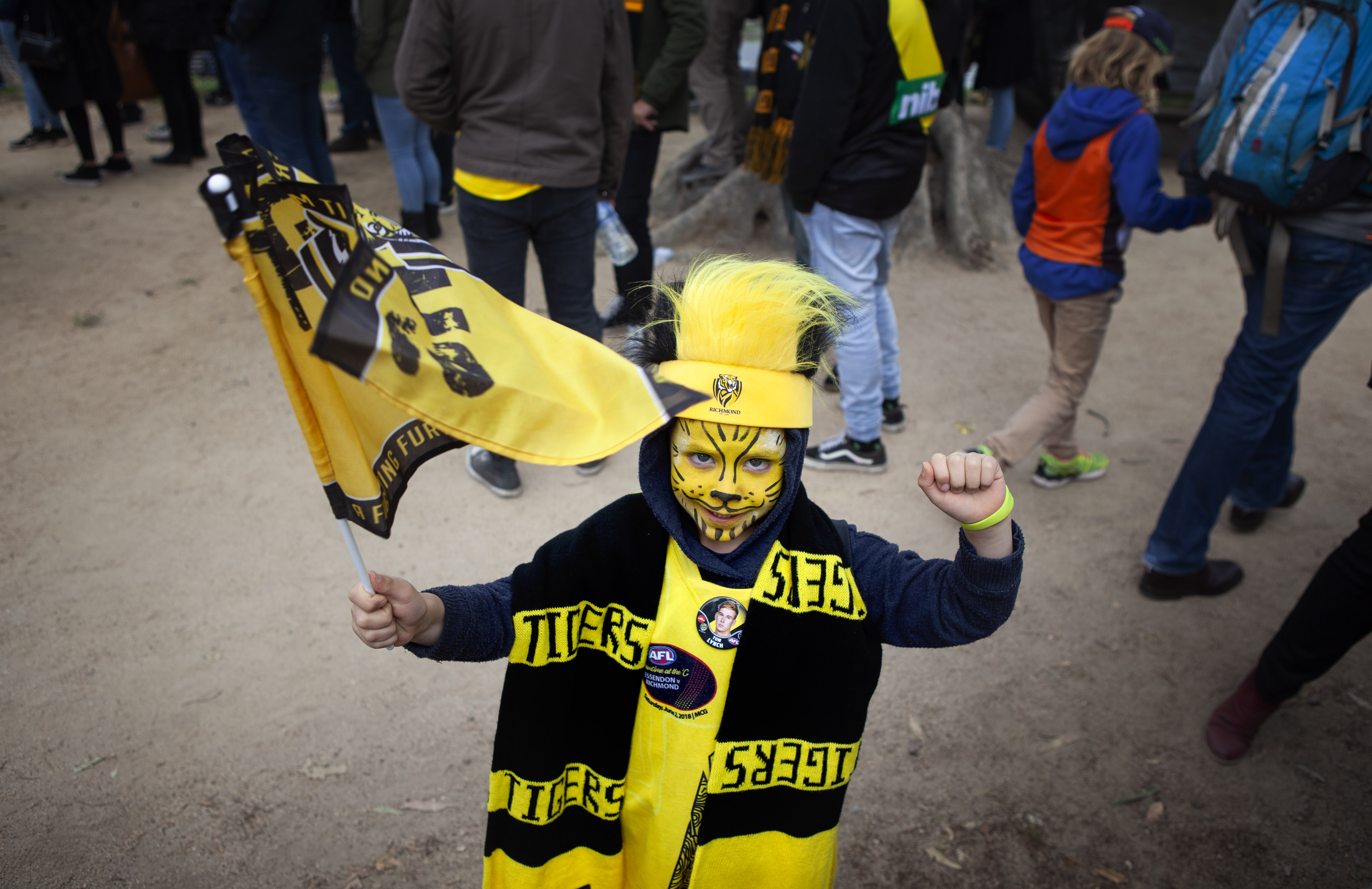 A young boy, appropriately named Dusty, heading into the big match.  He left happy - Richmond winning, and the other Dusty winning the Norm Smith Medal for best on ground.