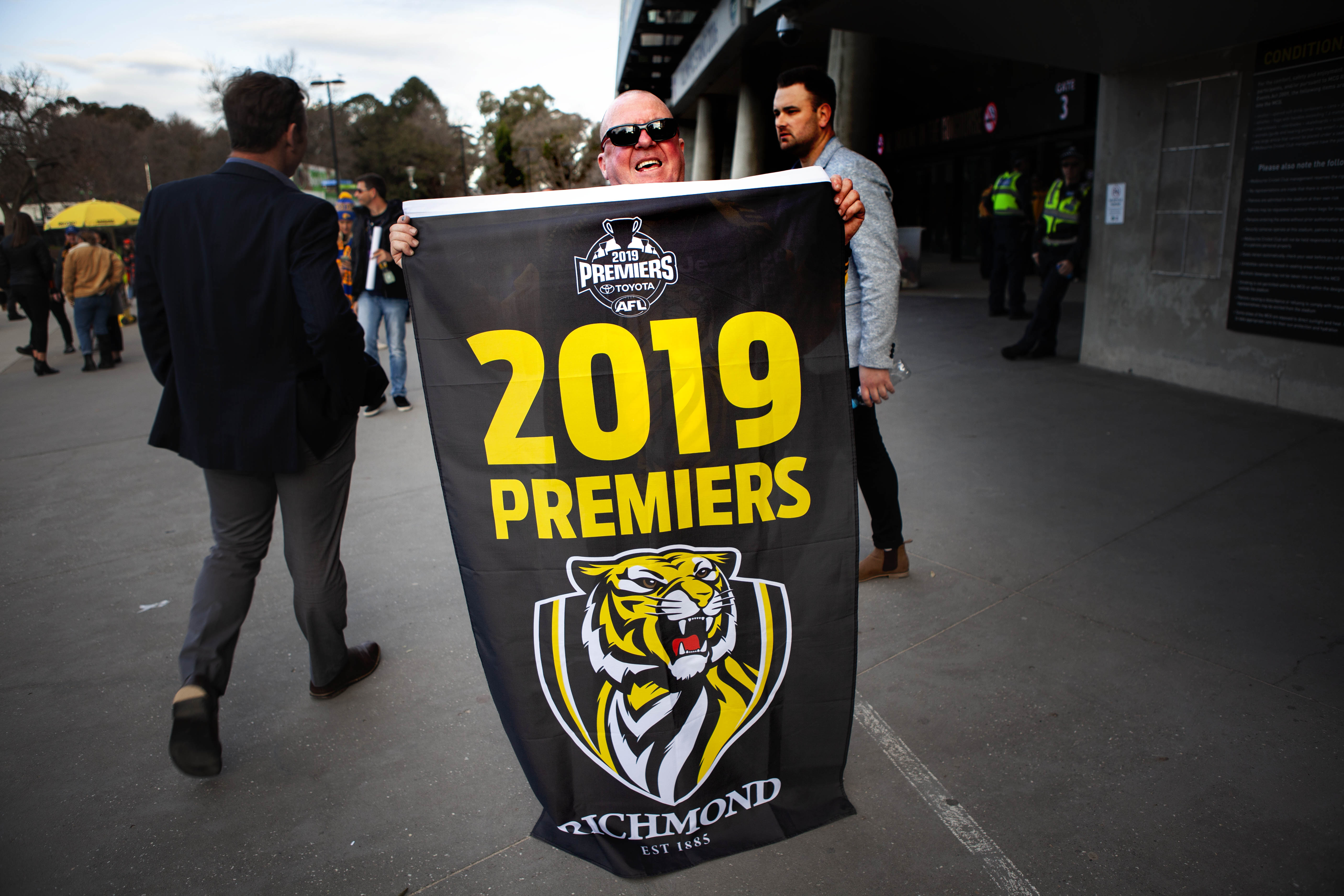 Families, flags and footy records on show as AFL season comes to a close