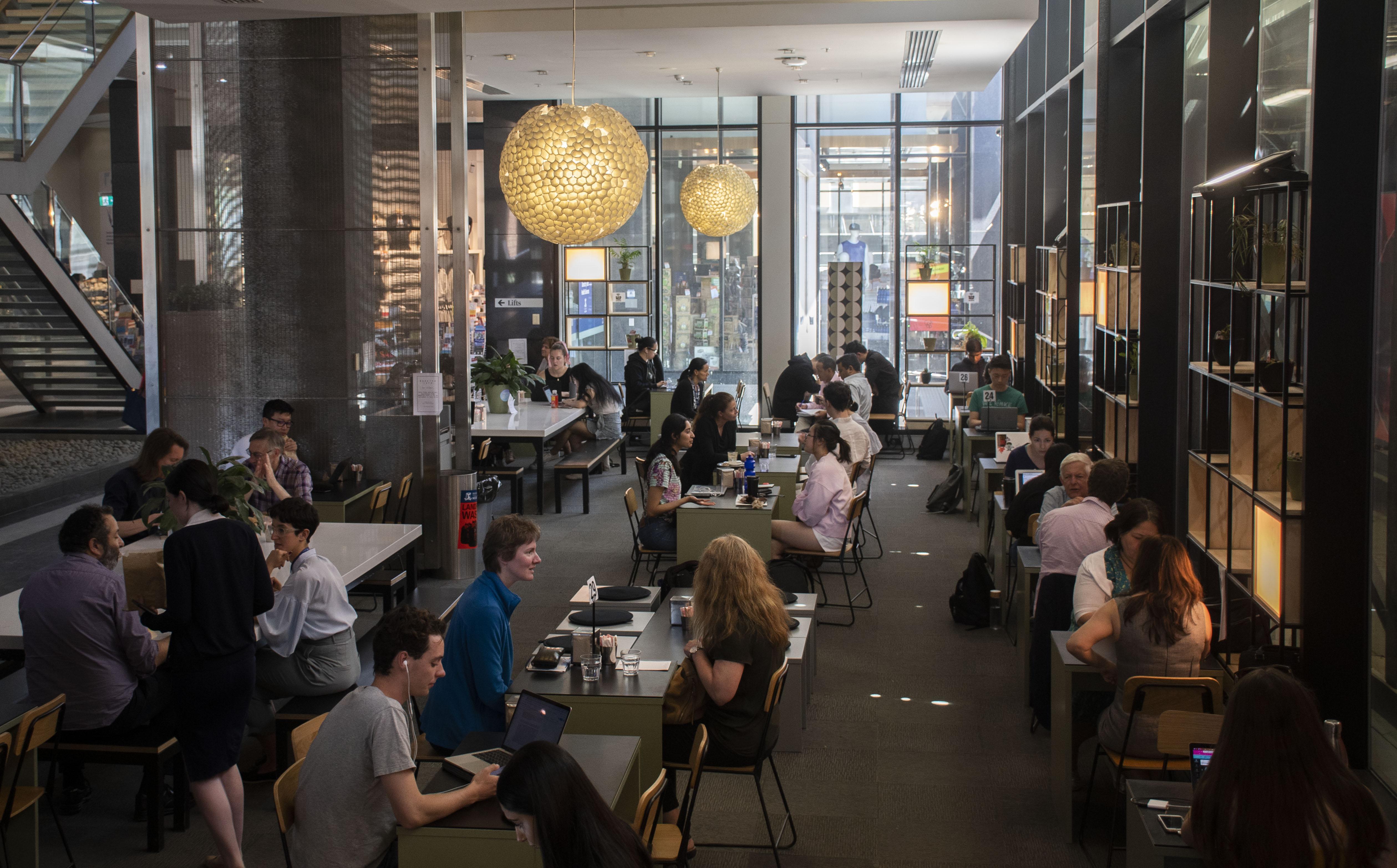 Coffee drinkers inside the Baretto Espresso Coffee store on Barry Street in Carlton.