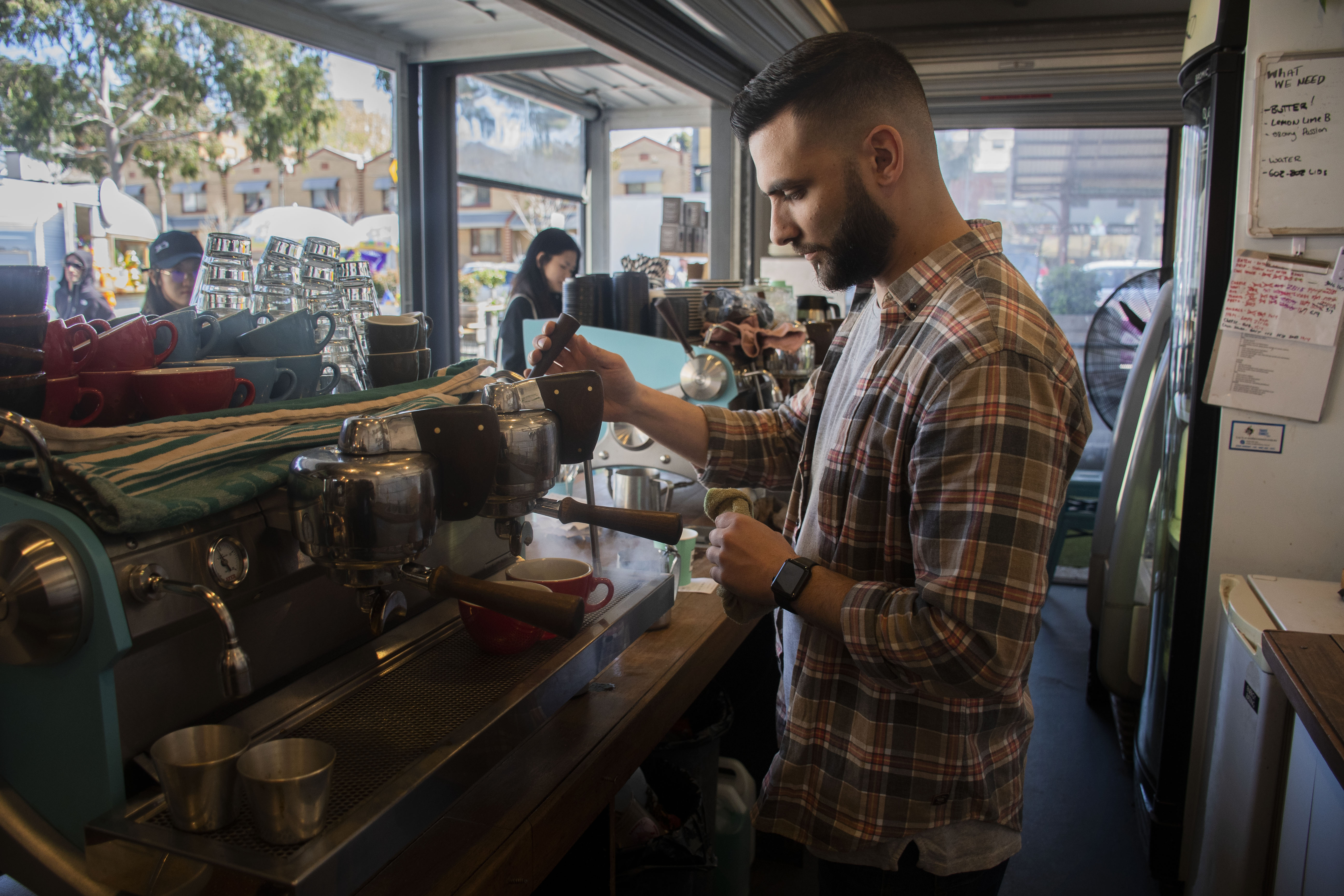 """The average coffee consumption in Melbourne is quite large. Monstafa Elavoubi, the owner of Padre Coffee at the Queen Victoria Market, is makes coffee for his customers, and says that """"we usually sell on average hundreds of cups of coffee a day and thousands a week""""."""