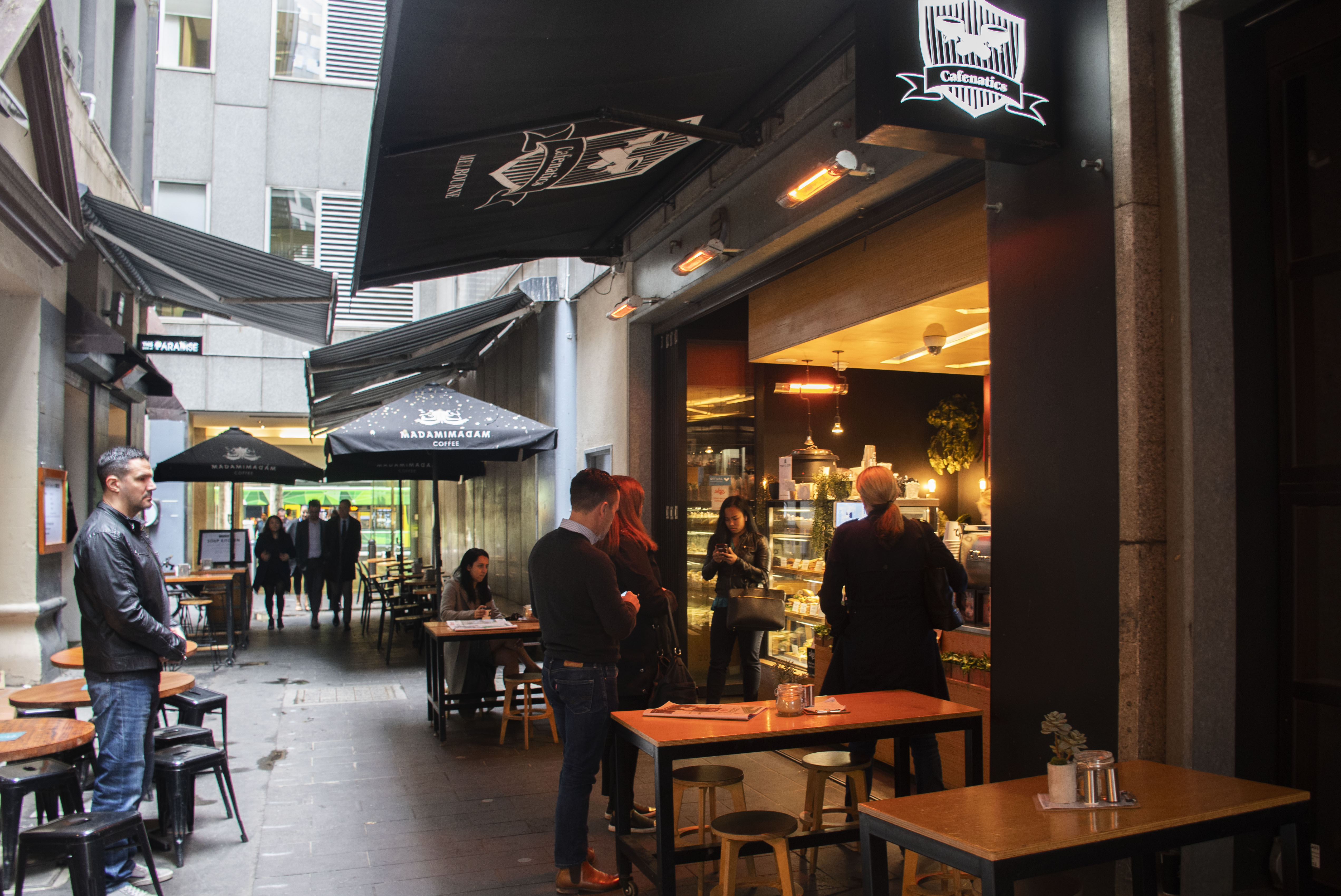 People wait to order and pick up their coffees on a Thursday morning at Cafenatics, which is tucked away in a lane off of Collins Street.