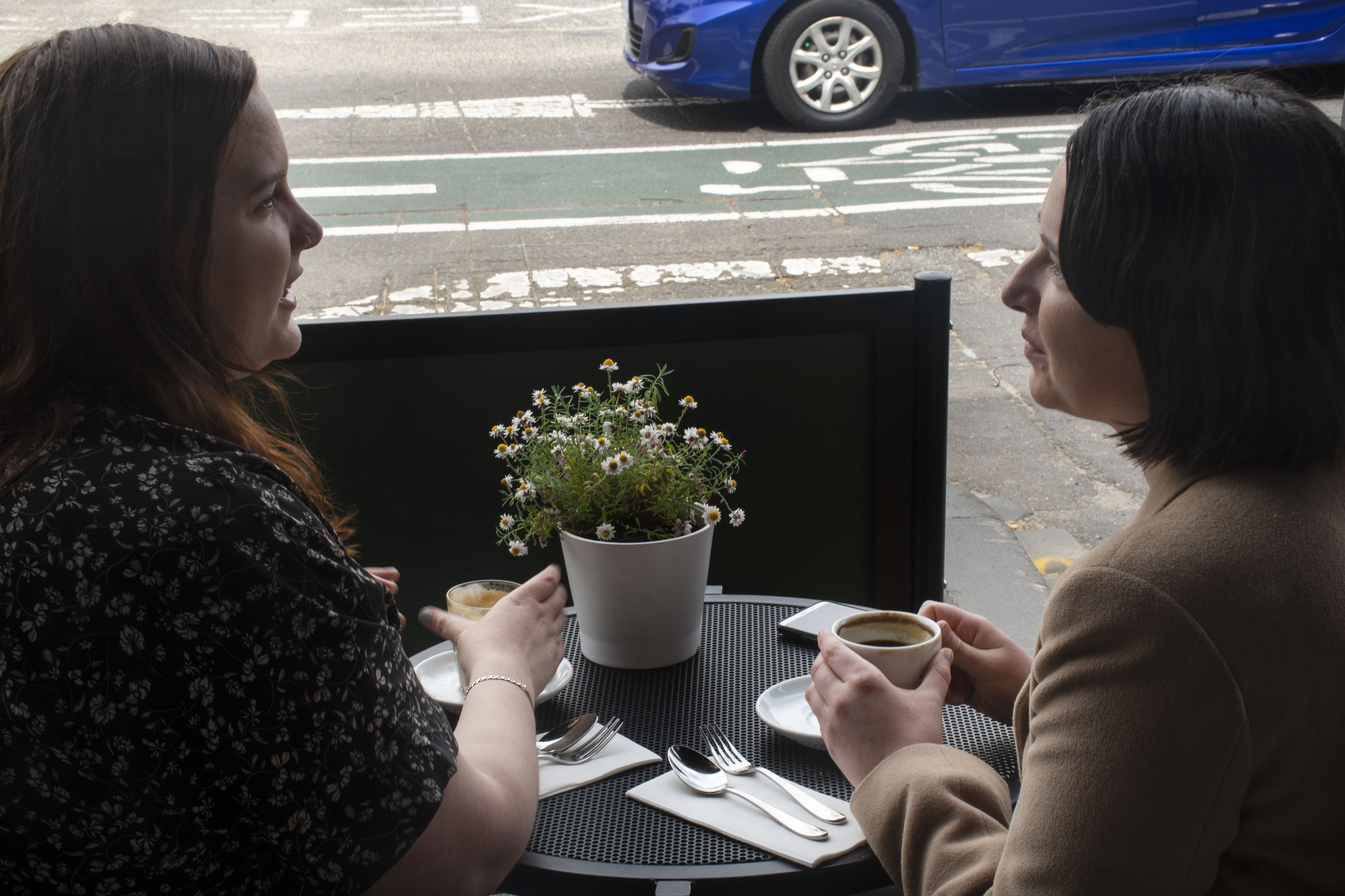 Nicole Earle (left) and Laura Ferris (right) enjoy a coffee on a Sunday morning. They both say that coffee is important for them, and they usually have at least one cup a day.   Laura also says that she usually has her morning coffee at home.