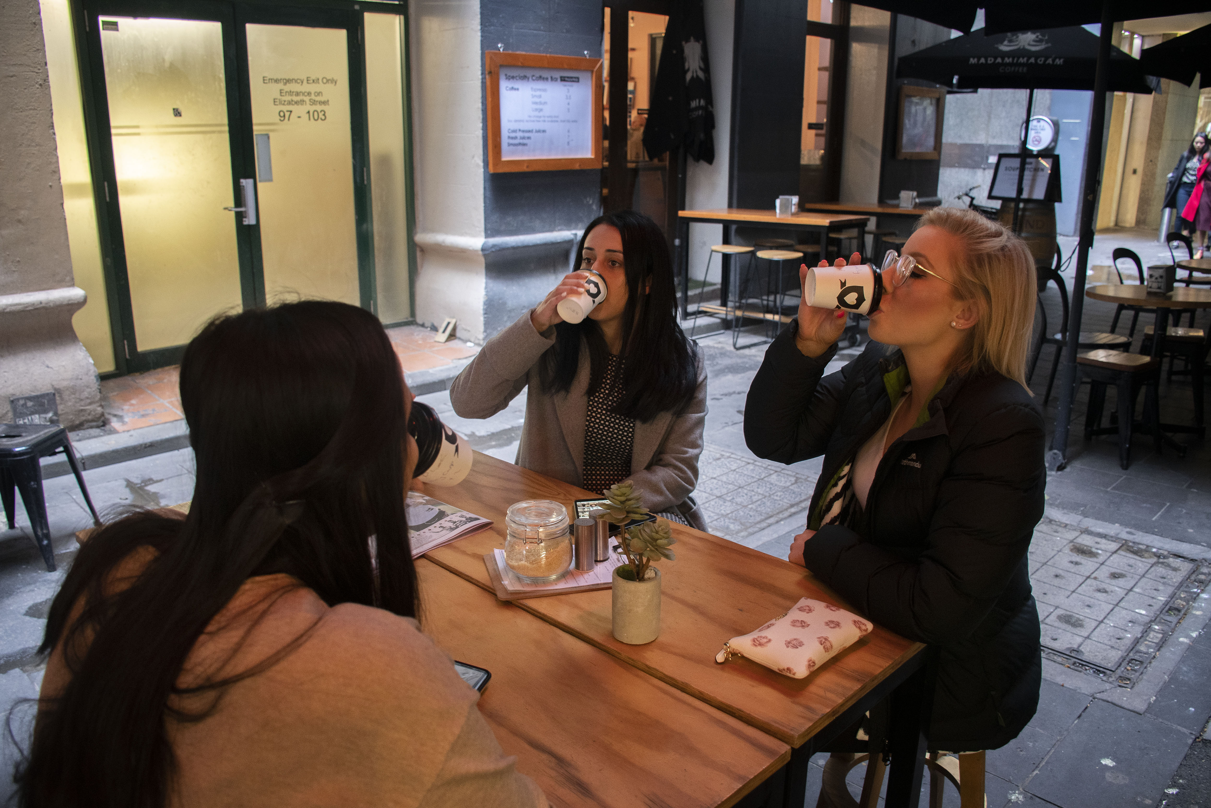Kealy Martin, Rhea D'Souza, and Jessica Takla treat themselves to a cup of coffee after finishing their night shifts.