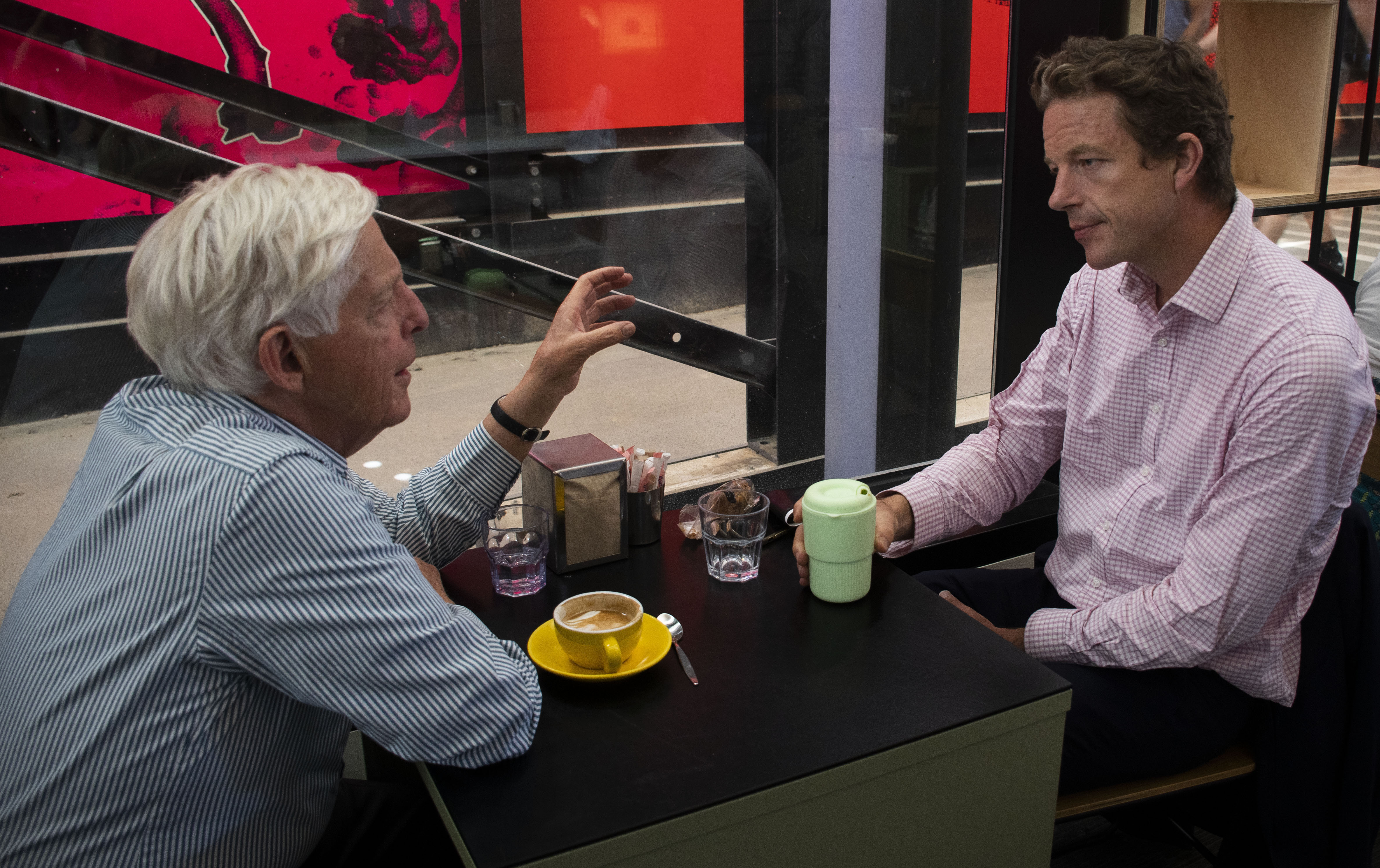 """Robin Jeffrey (left) and Craig Jeffrey (right) enjoy an afternoon coffee.  Craig says """"I probably have two cups of coffee each day, and I have been using the swap cup almost one year. I think it is really convenient for people, and very friendly to the environment""""."""