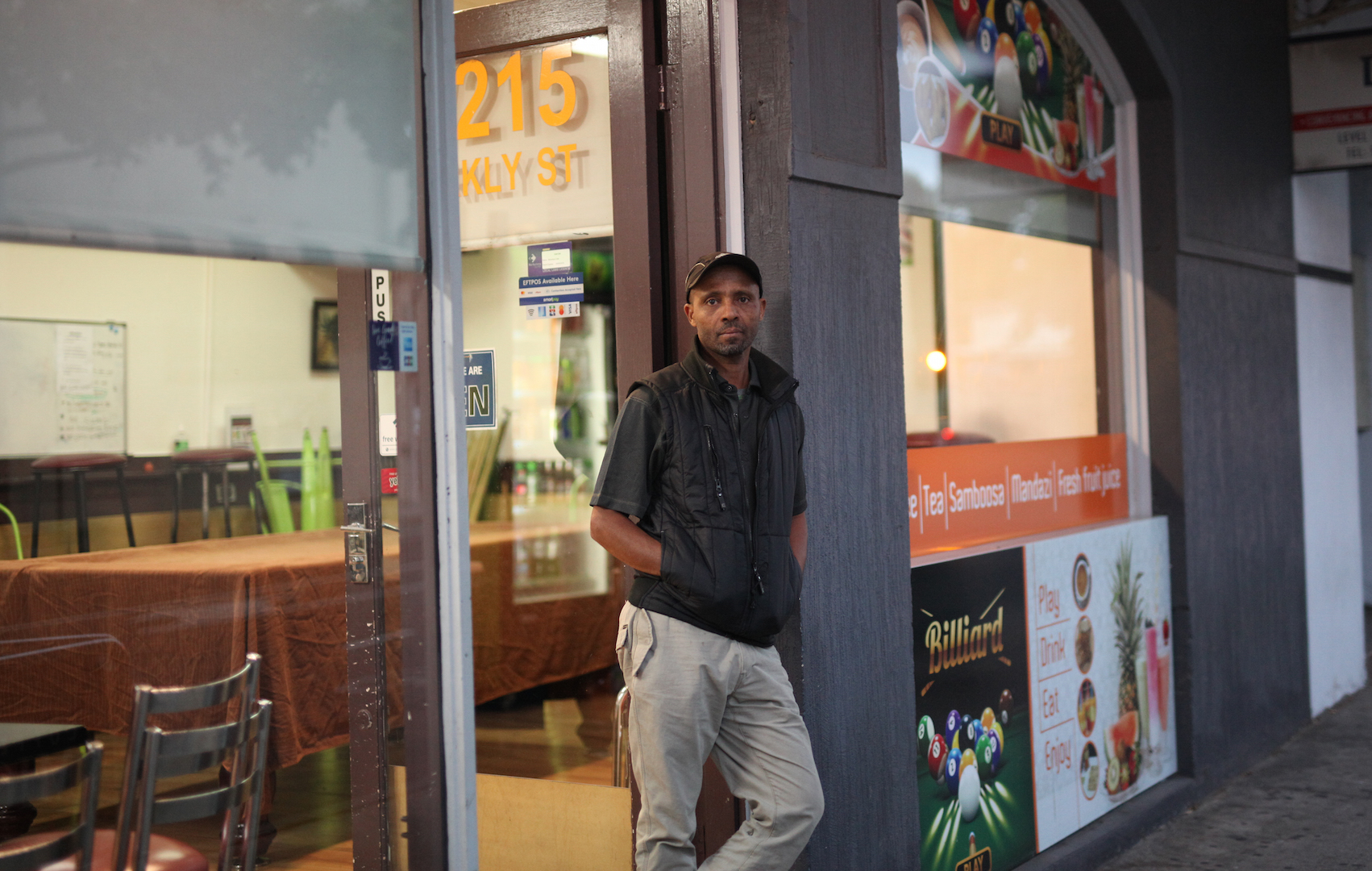Adane Mekonnen at the coffee shop he set up four years ago. As he closed the doors last night, he wondered when – or if – he would open them again. Photo: Else Kennedy