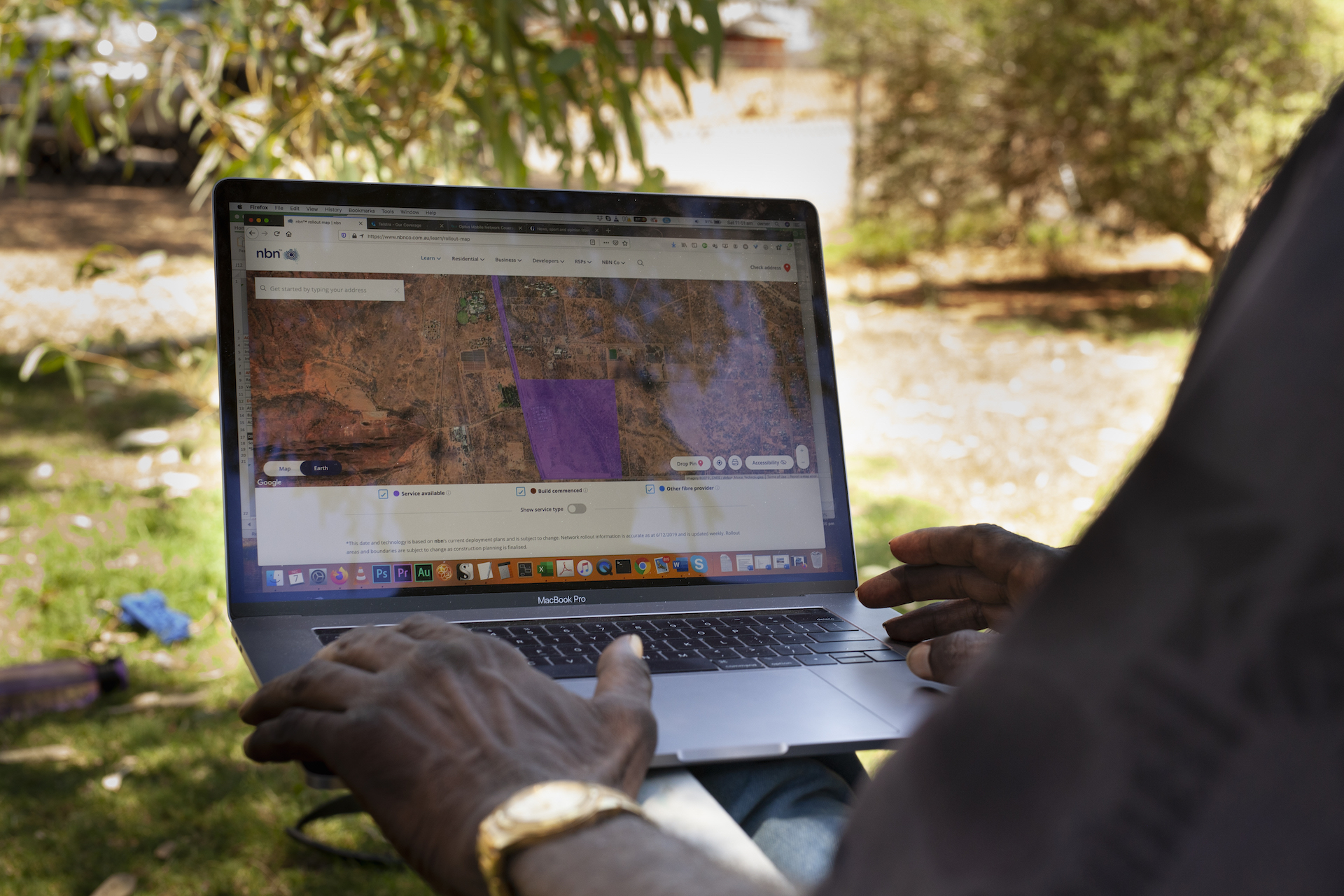 Christopher Poulson from Karnte camp looking at the NBN coverage map. Photo: Else Kennedy