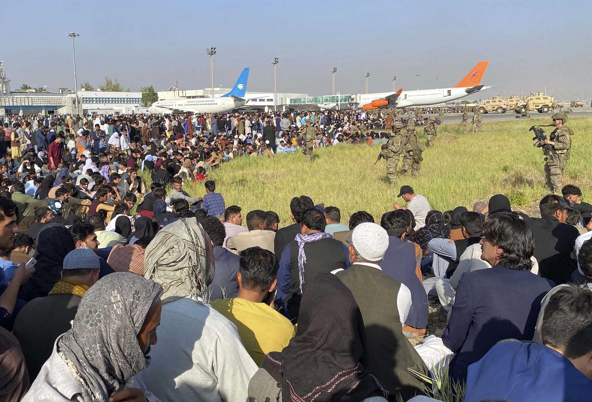 Afghan staff in peril, aid agencies wrestle security versus mission